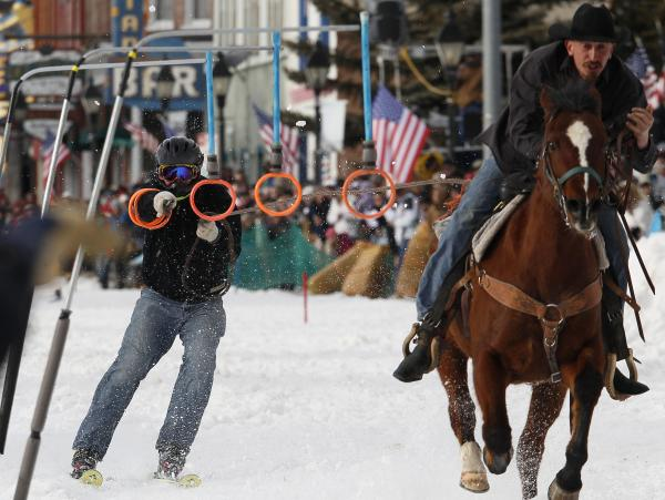 A horseman pulls a skier down the street in Leadville, Colo., in March, during the city's annual skijoring event. It was the event's 62nd year.