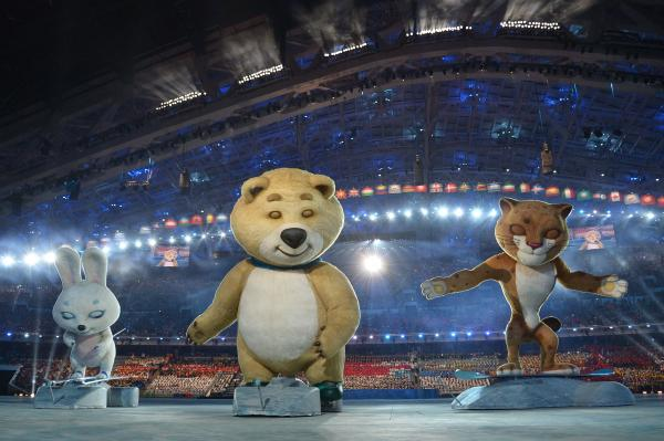 The 2014 Sochi Winter Olympics official mascots — the Leopard, the Polar Bear and the Hare — take part in the ceremony.