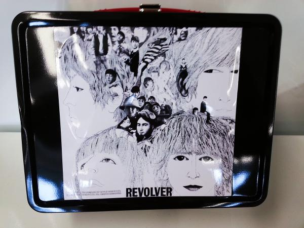 The Beatle's 1966 album <em>Revolver</em> is depicted on a retro-style, modern metal lunchbox.