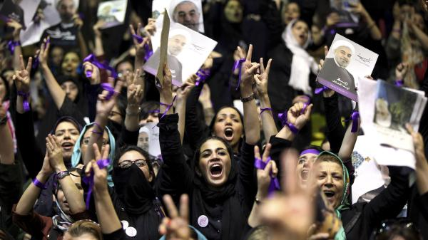 Female supporters of Hassan Rouhani, then an Iranian presidential candidate, chant slogans during a campaign rally in Tehran, Iran, on June 8, 2013. Rouhani has embarked on a diplomatic outreach program since taking office.