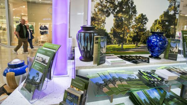 Forest Lawn funeral services has a kiosk at the Glendale Galleria mall in Glendale, Calif., to reach potential customers who may not want to visit a funeral home.