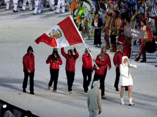 File photo of Roberto Carcelen of Seattle carrying the Peruvian flag at the 2010 Winter Olympics in Vancouver.