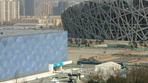 China's National Stadium, right, and National Aquatics Center, cost half a billion dollars to build and struggle to attract visitors.