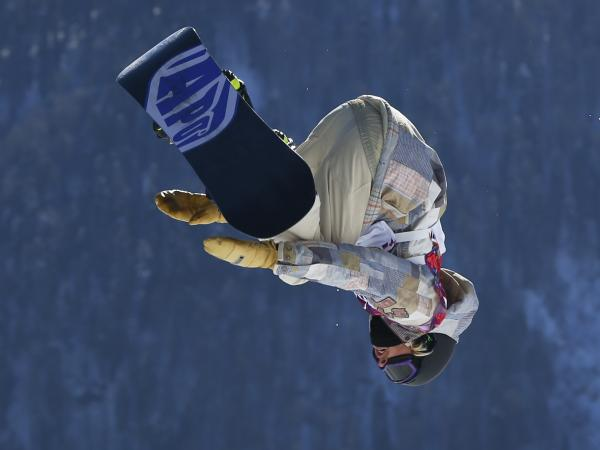 Sage Kotsenburg takes a jump during the men's snowboard slopestyle final at the 2014 Winter Olympics on Saturday.