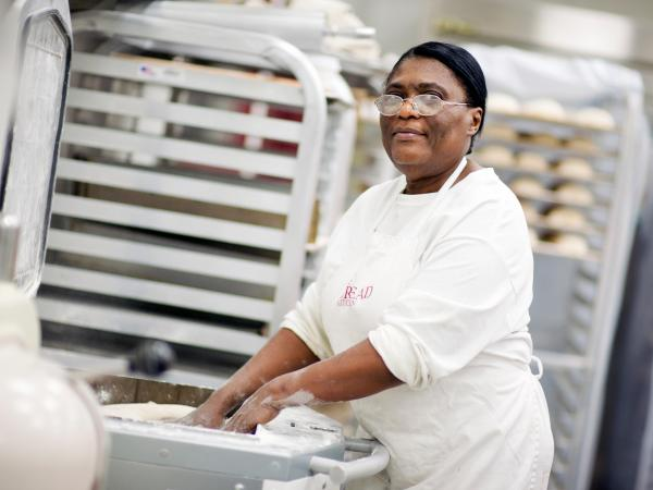 Hot Bread Kitchen graduate and product coordinator Marie Poisson divides focaccia dough.