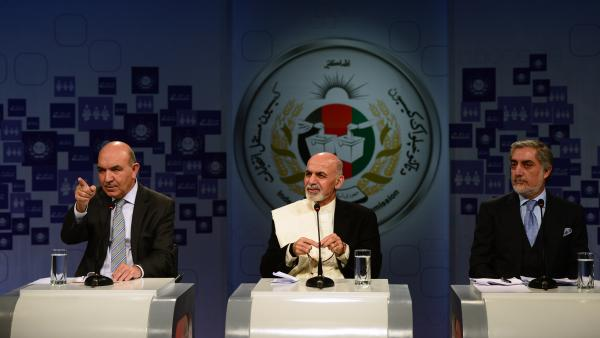 Afghan presidential candidates Qayum Karzai (from left), Ashraf Ghani and Abdullah Abdullah take part in a televised debate in Kabul on Saturday. With President Hamid Karzai stepping down, the presidential election set for April 5 will mark the first time the country has changed leaders at the ballot box.