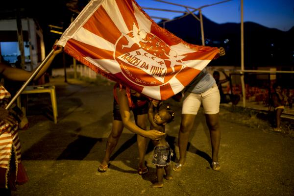 Residents hang out in Salgueiro, where the Salgueiro samba school has a smaller, informal samba group called Raizes Da Tijuca.