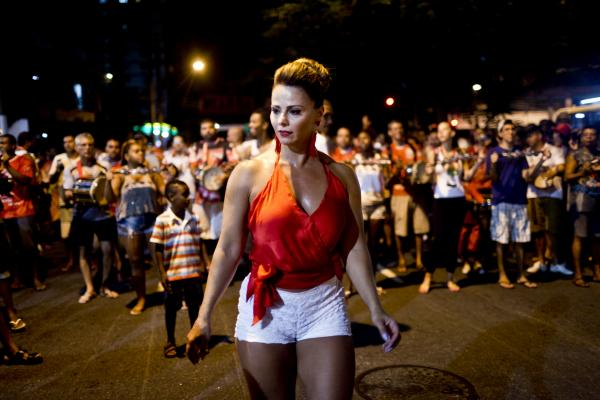 Viviane Araujo, a Salguiero samba school queen, performs at a rehearsal for Carnival in Rio de Janeiro. Marcello da Cunha Freire, vice president of the popular samba school, was murdered last month in a drive-by shooting.