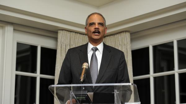 Eric Holder, attorney general of the United States, speaks at a Feb. 7 reception for baseball Hall of Famer Hank Aaron in Washington.