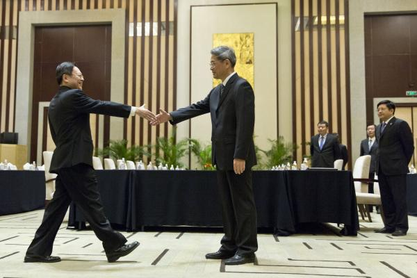 Wang Yu-chi, head of Taiwan's Mainland Affairs Council, left, shakes hands with Zhang Zhijun, director of China's Taiwan Affairs Office, right, before their meeting in Nanjing, China.