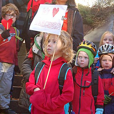Elementary school students in North Carolina stand outside their school in November, during an event organized by teachers to protest changes in public education.