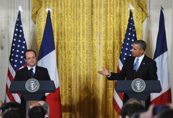 U.S. President Barack Obama and French President Francois Hollande hold a joint press conference during a State Visit in the East Room of the White House in Washington, DC, on February 11, 2014. (Jewel Samad/AFP/Getty Images)