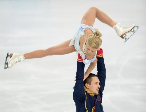 Russia's Maxim Trankov and Russia's Tatiana Volosozhar perform during the Figure Skating Pairs Team Short Program at the Iceberg Skating Palace during the Sochi Winter Olympics on February 6, 2014. (Jung Yeon-Je/AFP/Getty Images)