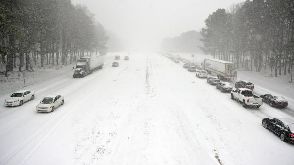 Traffic creeps along Wade Avenue in Raleigh, N.C., where commuters were caught on roads despite officials' encouragement not to travel.