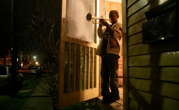"Eleven-year-old Jaron ""Bear"" Williams practices trumpet before marching in his first Mardi Gras season. <em>The Whole Gritty City</em> follows young student marching bands as they prepare for coveted spots in the New Orleans parade."
