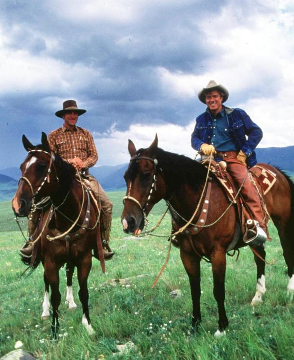 Redford (right) directed and starred in <em>The Horse Whisperer</em> in 1998. He's pictured above with real-life horse whisperer Buck Brannaman.