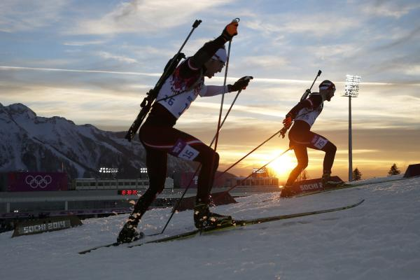 Austrians Simon Eder and Daniel Mesotitsch compete in the men's 20-kilometer individual biathlon race at the Winter Olympics in Krasnaya Polyana, Russia on Thursday.