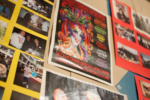 The walls of The Henry Turner Jr. Listening Room are covered in fliers and photos