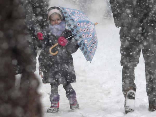 A little girl on her way to school Thursday in New York City. Mayor Bill de Blasio and his aides have come under fire for not closing the city's schools before a winter storm hit.