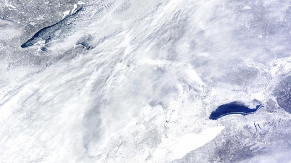 They're down there somewhere: The Great Lakes as seen from space on Wednesday. Lake Ontario, which has less ice than the others, is at the lower right. A bit of open water can be seen in Lake Superior, at the upper left.