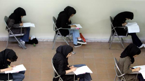 Iranian high school students sit for their university entrance examination in Tehran in 2009. Iran's economy has been struggling in recent years, and many graduates feel they have few career options.