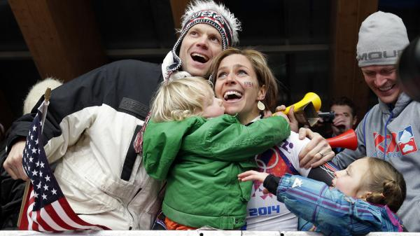 Noelle Pikus-Pace celebrates with friends and family, including her children, Traycen, left, and Lacee, after winning a silver medal in the women's skeleton at the 2014 Winter Olympics.