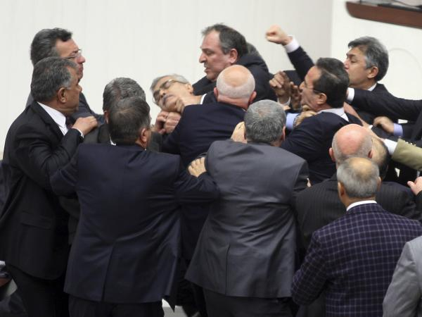 Members of Parliament from the ruling AK Party and the main opposition Republican People's Party scuffle during a debate on a draft law to give the government tighter control over the judiciary.