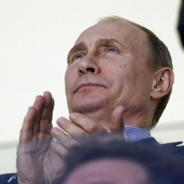 Russian President Vladimir Putin claps during the third period of a men's ice hockey game between the USA and Russia at the 2014 Winter Olympics, on Saturday in Sochi, Russia.