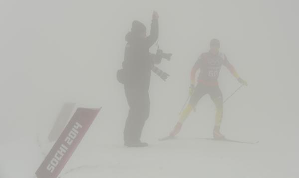 An athlete trains Monday at the Laura Cross-Country Ski and Biathlon Center Coaches at the biathlon course said fog and poor snow quality were big problems.