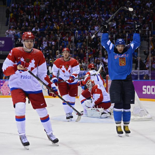 Score! Finland's Juhamatti Aaltonen (right) celebrates after scoring Wednesday during his team's victory over Russia.