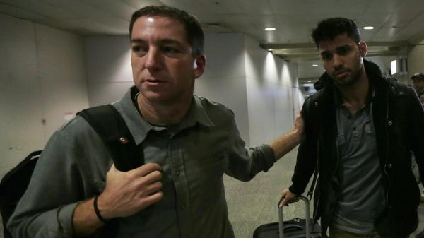 "Glenn Greenwald, left, and David Miranda after Miranda's arrival at Rio de Janeiro's International Airport on Aug. 19, 2013. Miranda had been detained for nine hours at London's Heathrow Airport. Authorities questioned him about Greenwald's reporting of the ""NSA leaks."""