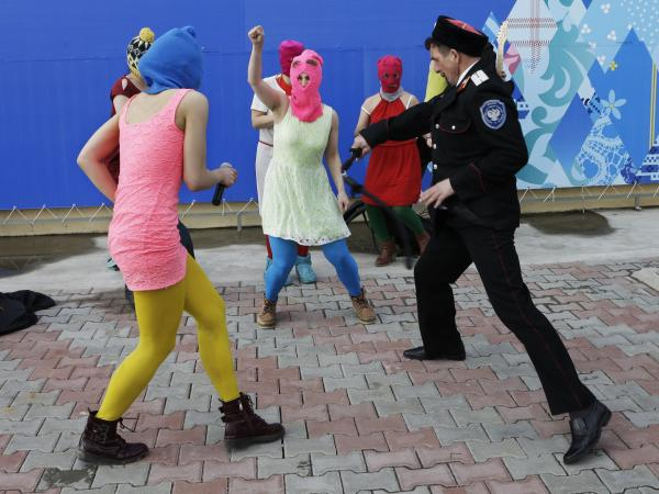 As members of the punk protest group Pussy Riot recorded a song and video in Sochi this week, a uniformed Cossack used a whip to try to stop them. The attack ended up being part of the band's video.