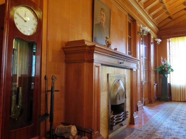 Two items in the conference room at the villa were not there during Stalin's time: the portrait over the fireplace (he claimed he didn't like portraits of himself) and the carpet (because he preferred to be able to hear approaching footsteps on wooden floors).