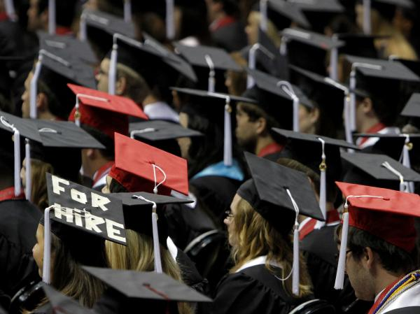 Students attend graduation ceremonies at the University of Alabama in Tuscaloosa, Ala. Two-thirds of college students now graduate with debt, owing an average amount of $24,000.