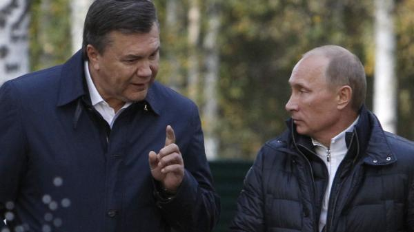Russian leader Vladimir Putin (right) listens to Ukrainian President Viktor Yanukovych during a meeting outside Moscow in 2011. Putin has supported Yanukovych in the current crisis in Ukraine, while the U.S. has been increasingly critical. This is one of many issues where Russia and the U.S. are at odds.