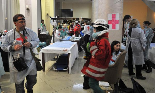 Medics and volunteers arrange a field hospital an hotel hall near Independence square in Kiev on February 20, 2014. (Genya Savilov/AFP/Getty Images)