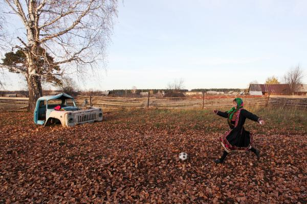 An eighth-grade student plays in a pick-up soccer match with her girlfriends in the Mari El Republic between the Russian cities of Kazan and Nizhny Novgorod.