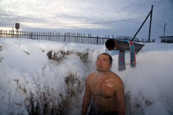 Meyram Moldakimov takes care of a water pump facility in a village near Novosibirsk and washes under this pipe twice a week, no matter what the weather.