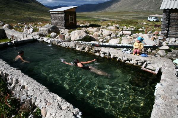 Swimmers enjoy a thermal spring with water that contains radon, a radioactive element. The locals revere the spring near the Mongolian border in Altai for its healing powers.