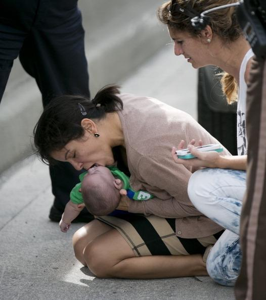 Pamela Rauseo performs CPR on her nephew, 5-month-old Sebastian de la Cruz, after pulling over on the side of Florida state road 836 on Thursday.