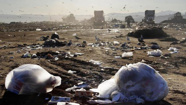 Trucks dump trash at the Puente Hill Landfill in Puente Hills, Calif., on October 31, 2013. The nation's largest landfill is now covered with soil and closed, and will one day be a park.