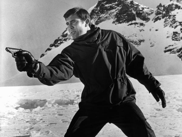 George Lazenby takes aim at his pursuers in a scene from the 1969 film <em>On Her Majesty's Secret Service</em>.