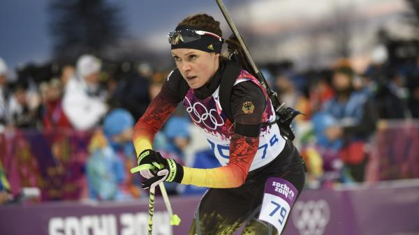 Germany's Evi Sachenbacher-Stehle has left her country's Olympic contingent — and Sochi — after testing positive for a banned stimulant. She's seen here in the biathlon earlier this week; Sachenbacher-Stehle finished fourth.