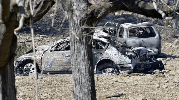 Burned-out vehicles sit among the ruins following a natural gas pipeline explosion in Kentucky on Thursday.