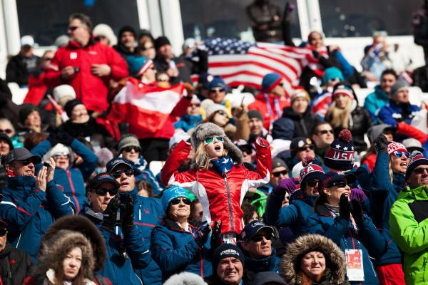 Fans watch Olympic alpine skiing action at the Rosa Khutor venue.