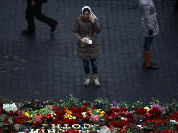 A woman cries Sunday in front of a memorial to people killed in clashes with police in Independence Square, Kiev.