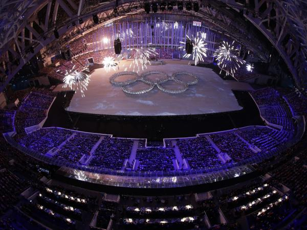 Pyrotechnics explode over dancers formed into the Olympic rings during the closing ceremony of the 2014 Winter Olympics, on Sunday.