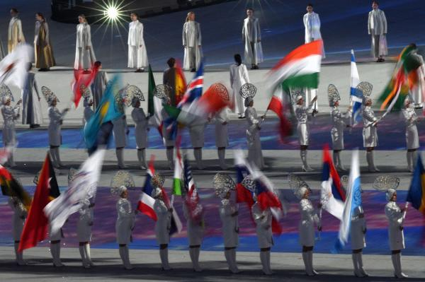 Flag bearers parade ahead of athletes.
