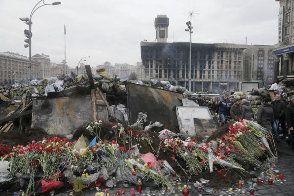 Flowers cover one of the barricades heading to Kiev's Independence Square, the epicenter of the country's recent unrest. The Kiev protest camp at the center of the anti-President Viktor Yanukovych movement filled with more and more dedicated demonstrators Sunday morning.