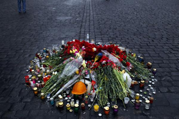 A small memorial to people killed in clashes with the police stands on a street in Kiev.